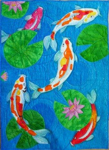 Koi Pond, raw edge applique hand-painted and commercial fabric. 40 x 42